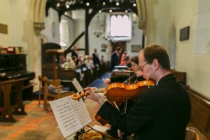 Our string duo playing pre-ceremony music for a wedding in Berkshire