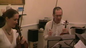 Rehearsing a string quartet - Vaughan Jones and Louise Bevan discussing the music