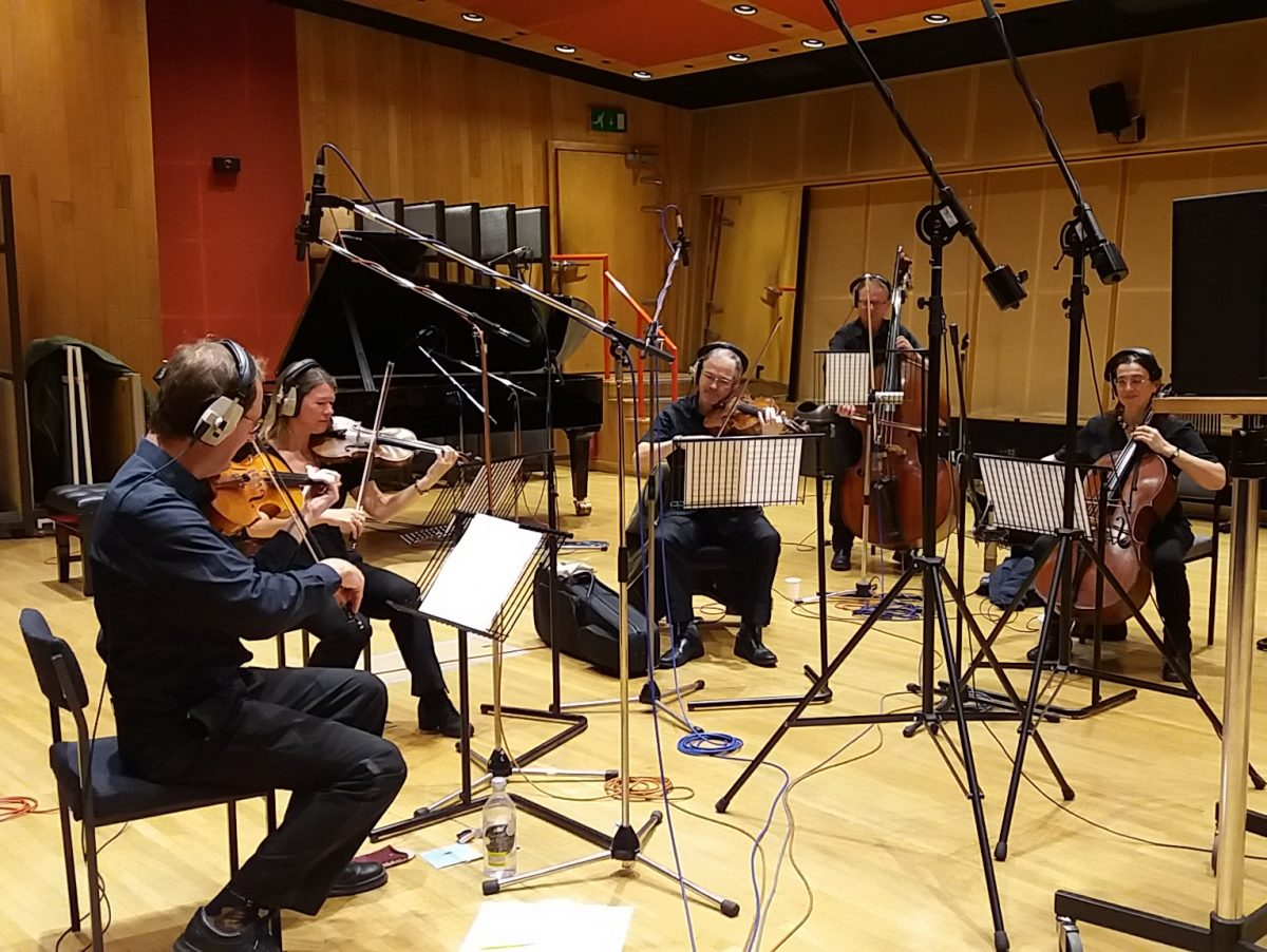 Session musicians recording strings