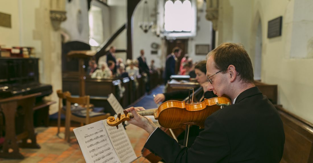 Manor House String Duo performing at a wedding ceremony in Berkshire