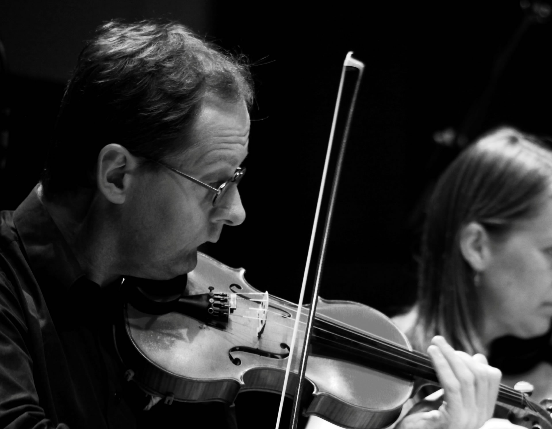 Violinists performing for a recording session